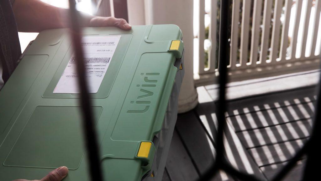 a meal kit customer holds an insulated, reusable Liviri Fresh box